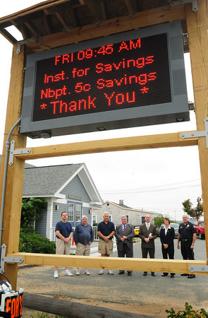 Newbury: The Newburyport Five Bank and Institution for Savings donated money for this sign outside PITA Hall on Plum Island which we show public announcements and emergency messages when needed. Bank and local officials checked out the now operating sign, from left, hall manager Frank Pierce, Newbury Selectman Joe Story; PITA head Ron Barrett, Newburyport Five President Richie Eaton, Institution President Michael Jones, Newburyport Five President-elect Janice Morse and Newburyport Police Lt. RIck Siemasko. Bryan Eaton/Staff Photo