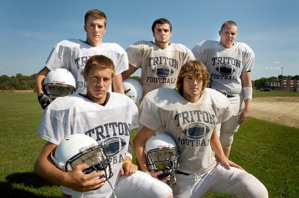 Byfield: Triton High football captains, front, Blaise Whitman, left, and Cody Miller. Back, from left, Luke Miller, Ryan Carney and Andrew McManus. Bryan Eaton/Staff Photo
