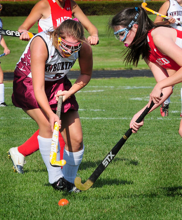 Newburyport: Newburyport's Maddie Stanton, left, goes to head with a Masconomet player yesterday at Fuller Field. Bryan Eaton/Staff Photo