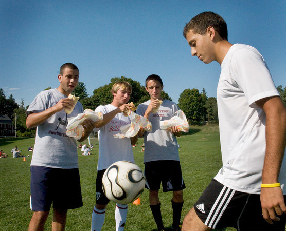 Newburyport: While teammates, from left, Mike Falite, Justin Krusemark and Matt Orlando can eat all they want, Newburyport High star soccer player Yazid Eideh, right, has been fasting for Ramadan. Bryan Eaton/Staff Photo