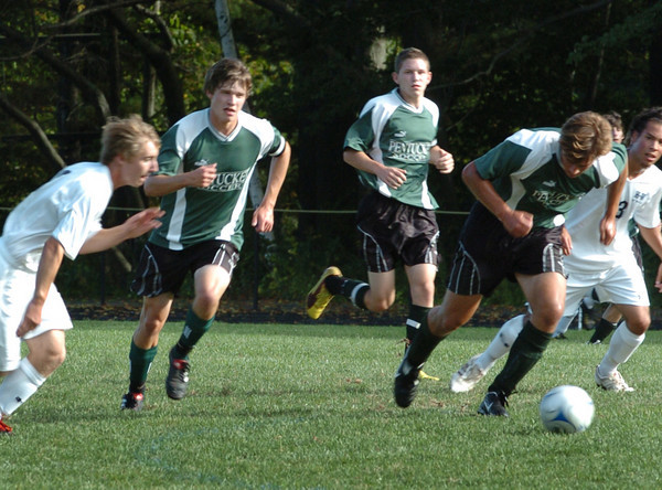 Hamilton: Dan Greene, second from left, races for the ball with teammates against Hamilton-Wenham. Bryan Eaton/Staff Photo