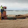 Salisbury: Crews lay giant pipes along Salisbury Beach to pump dredged sand from the Merrimack River to replenish the dunes. Bryan Eaton/Staff Photo