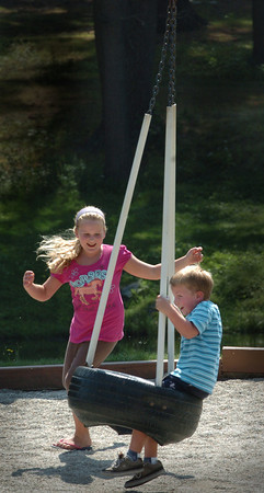 Amesbury: Meghan Little, 8, and Ethan Batchelder, 5, play on the tire swing at Amesbury Town Park yesterday afternoon. The students of the Seventh Day Adventist School in South Hampton were on a harbor cruise out of Portsmouth for an outing, then came to the park for lunch and play. Bryan Eaton/Staff Photo
