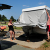 Salisbury: Guy Champagne, his wife Jose and daughter, Gabrielle, left, close up their camper at Salisbury Beach State Reservation as people at the campground are ordered to leave over concerns of Hurricane Earl. The family, from Quebec City, Quebec, has been coming there for 30 years and this is the second time they had to evacuate. Bryan Eaton/Staff Photo