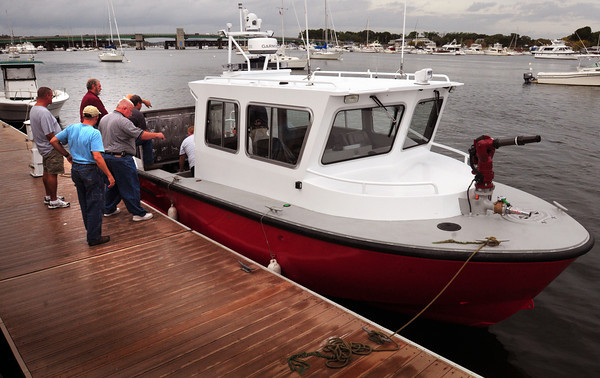 Newburyport: Members of the Charlotte, North Carolina Fire Department board a firefighting boat at Newburyport's waterfront for instruction by designers, Response Marine, Inc. of Newburyport and builder Viking Welding from Kensington, N.H. The boat will be used on the large dammed Lake Wylie, southeast of Charlotte. Bryan Eaton/Staff Photo