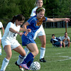Byfield: Triton's Sam Marino battles with Georgetown's Nicoline Holland as teammate Jen Rock moves in. Bryan Eaton/Staff Photo