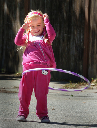 Newburyport: Alex Trimper, 5, tries her hardest to keep her hula hoop from falling to the ground. The kindergartner was at recess at the Brown School where children got to play with different toys. Bryan Eaton/Staff Photo