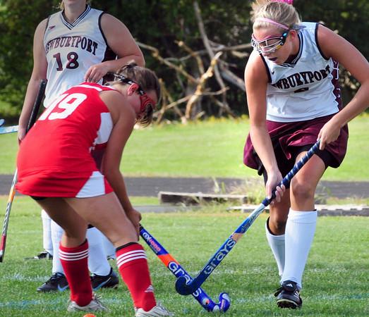 Newburyport: Newburyport's Haley Johnson, right, moves the ball down the field past Masconomet on Monday afternoon. Bryan Eaton/Staff Photo