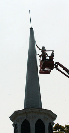 Amesbury: The steeple of the Main Street Congregational Church in Amesbury gets its steeple painted on Wednesday morning. The church is getting other repairs as well. Bryan Eaton/Staff Photo