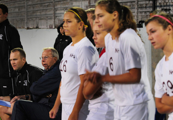 Newburyport: Newburyport girls soccer coaches Kevin Sheridan, left, and Robb Gonnam watch their team host Triton on Monday night. Bryan Eaton/Staff Photo