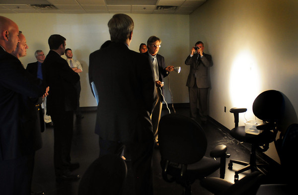 Newburyport: Steve Johnson, Ph.D. and Chief Technical Officer of Solais LED and Lighting shows off an led lamp to local elected officials and business leaders at new Clean-Tech center in Newburyport's industrial park. Bryan Eaton/Staff Photo