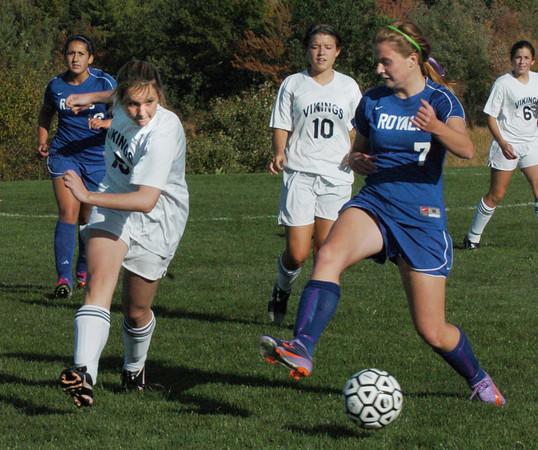 Byfield: Triton's Nicole Godfrey defends against Georgetown's Coley DeMaio yesterday in Byfield. Bryan Eaton/Staff Photo
