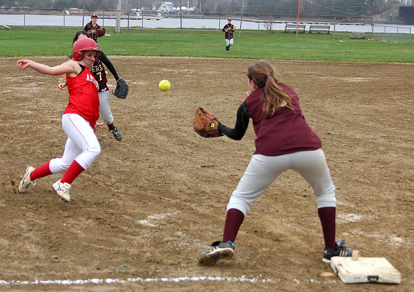 Newburyport: Amesbury's Anna Kate Webber (8) can't beat the throw to third base as Newburyport's Maddie Stanton (5) would make the tag during Monday afternoon's game at Cashman Park. Photo by Ben Laing/Staff Photo