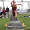 Newburyport: Newburyport's Liza Twomey takes off during the long jump event at Wednesday's track meet against Triton and Wilmington at the Fuller Field. Photo by Ben Laing/Staff Photo