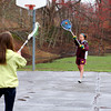 Newburyport: Despite the drizzle Tuesday afternoon, Lily Galerzano, right, and Ali Peffer, play catch with the lacrosse ball at March's Hill in Newburyport. The pair of Newburyport High School students are on spring vacation this week. Photo by Ben Laing/Staff Photo
