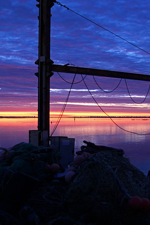 Newburyport: A pile of fishing gear near the Harbormaster's office in Newburyport is greeted by the sun rise over Plum Island Monday morning. Photo by Ben Laing/Staff Photo