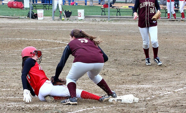 Newburyport: Maddie Stanton (5) of Newburyport applies a tag to Amesbury's Alexis Boswell (10) during Monday afternoon's match up at Cashman Park in Newburyport. Photo by Ben Laing/Staff Photo