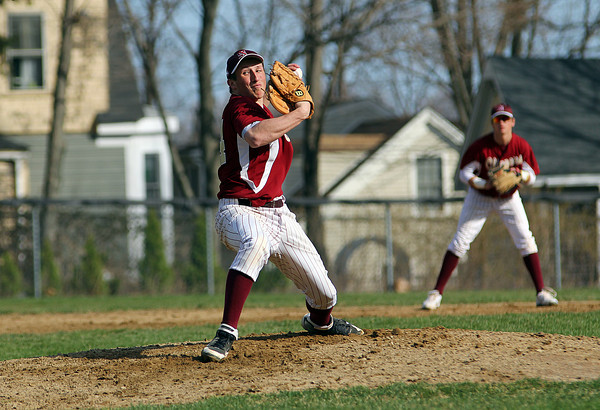 Newburyport: Pitcher Ryan O'Connor (14) delivers a pitch early in Thursday's game against North Reading at Newburyport High School. Photo by Ben Laing/Staff Photo
