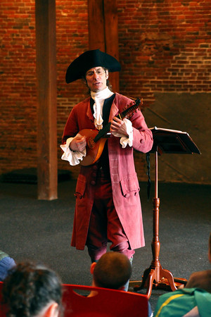 Amesbury: Tobias Tripp, played by Larry Young, plays a colonial tune for children at the Amesbury Cultural Center Thursday afternoon, as the Amesbury Library sponsored Growing Up in Colonial America for children during vacation week. Photo by Ben Laing/Staff Photo