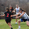 Byfield: Triton's Erin Curely (16) checks a North Andover player during Monday afternoon's lacrosse game in Byfield. Photo by Ben Laing/Staff Photo