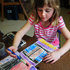 "Amesbury: Morgan Collins, 8, watercolors her ""hickory-dickory-dock"" clock in Marianne Curry's kindergarten at Amesbury Elementary School on Wednesday. The children are going to later create a clockface to put on it and create their own character, over the mouse of the famous rhyme, to climb up it. Bryan Eaton/Staff Photo"