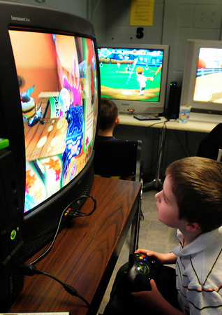"""Salisbury: Travis Trimble, 6, plays a video game """"Cat in the Hat"""" at the new video games room, which had been an unused storage area, at the Boys and Girls Club in Salisbury. The room is open in the afternoon for children for 15 minutes each, with games and playstations donated by parents and other in the community. Bryan Eaton/Staff Photo"""