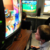 "Salisbury: Travis Trimble, 6, plays a video game ""Cat in the Hat"" at the new video games room, which had been an unused storage area, at the Boys and Girls Club in Salisbury. The room is open in the afternoon for children for 15 minutes each, with games and playstations donated by parents and other in the community. Bryan Eaton/Staff Photo"