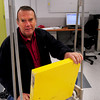 Newburyport:Newburyport resident Cliff Goudey, an engineer with Resolute Marine Energy, a company that is looking to develop clean energy from ocean waves, shows a rig that sits on the ocean floor with wave energy moving the yellow pad which creates electricity Resolute is the second company to move into the city's green business incubator. Bryan Eaton/Staff Photo