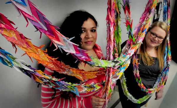 Byfield: Triton High School seniors Vanessa Velasquez, 17, left, and Kristy LaPlante, 18, along with several friends are on their way to making 1,000 paper cranes to send to Japan. Bryan Eaton/Staff Photo