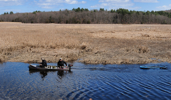 Byfield: Pat Brown and Peter Yukins of First Light Anglers in Rowley pull a floating cage of brown and brook trout to release into sections of the Mill River off Route One in Byfield across from the entrance to the Governor's Academy. Bryan Eaton/Staff Photo