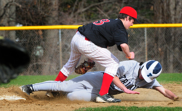 Amesbury: Amesbury second baseman Tom Connors tags out Triton's Dmitri Hunt in a steal attempt. Bryan Eaton/Staff Photo