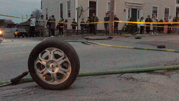 Newburyport: A tire from a car that crashed on Merrimac Street in Newburyport early last night sits in front of the Park Lunch, another tire rolled to the side of the restaurant between parked cars. Witnesses believe a woman was in the Ford Focus and was going at a very fast speed before hitting a telephone pole just west of Pop Crowley Lane. Bryan Eaton/Staff Photo
