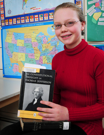 Byfield: Ania Burgess, 12, is participating in a History Day essay competition on Saturday. She has written a paper on The Louisiana Purchase and won the district competition last month with Saturday's event being the state competition. Bryan Eaton/Staff Photo