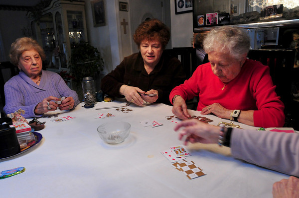 Seabrook: Playing a type of poker, friends, from left, Addie Caruso, Pearl Travis, dealing, Annie Bonacorsi and Sally Lahane look at their cards. Bryan Eaton/Staff Photo