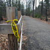 Salisbury: Pieces of police tape are still present near where a man was injured in a hatchet attack at the trail behind Lion's Park in Salisbury on Sunday afternoon. Bryan Eaton/Staff Photo