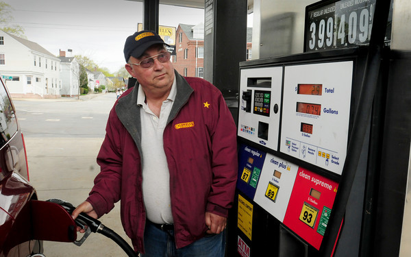 Newburyport: Wayne Cates pumps gas at 1/10th of a cent under $4 per gallon regular at Caldwell's Corner on Merrimac Street in Newburyport. Owner Rob Germinara says the price could top $4 with the next delivery from the supplier. Bryan Eaton/Staff Photo
