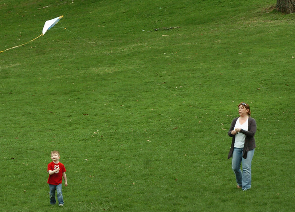 Amesbury: Hailey Mancini of Amesbury, and her son, Johnny, 3, flew a kite at Amesbury Sports Park in the warm wind yesterday morning. Bryan Eaton/Staff Photo