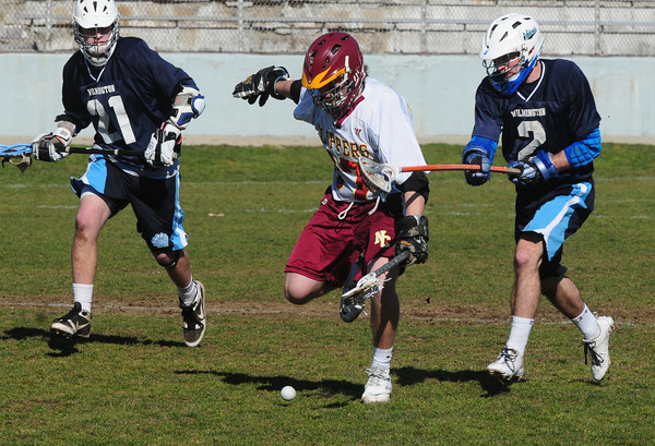 Newburyport: Newburyport's Sam Francis is tailed by two Wilmington players. Bryan Eaton/Staff Photo