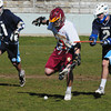 Newburyport: Newburyport's Sam Francis is tailed by two Wilmington players. Bryan Eaton/Staff Photo