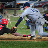 Amesbury: Triton first baseman Shon O'Leary picks off Amesbury's Tyler Lay on a steal attempt. Bryan Eaton/Staff Photo