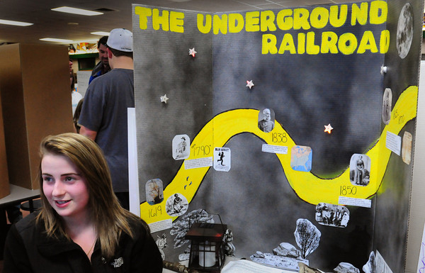 West Newbury: Amelia Desjardins, 14, talks about the Underground Railroad, which she researched, to visitors the Pentucket High School's History Fair put on by ninth-graders. Bryan Eaton/Staff Photo