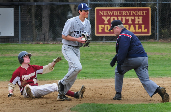 Newburyport: Triton second baseman Cam D'Agostino walks away with the ball as Newburyport's Sam Barlow is called out to close that half of the inning. Bryan Eaton/Staff Photo