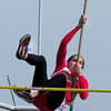 Byfield: Amesbury's Courtney Ouellet heads over the bar in the pole vault in a meet at Triton. Bryan Eaton/Staff Photo