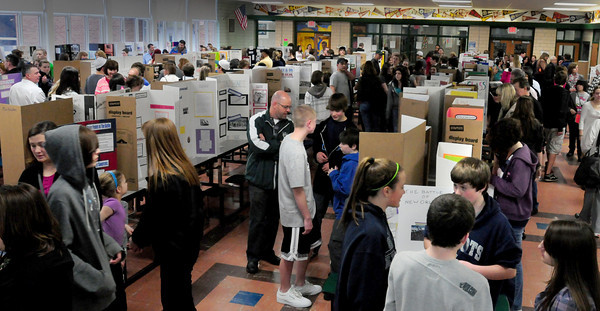 West Newbury: The Pentucket High School cafeteria was packed with parents and students for the freshman history fair. The students researched people and events from the past and created a display of their results. Bryan Eaton/Staff Photo