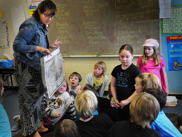 Amesbury: Debra Block shows off a replica of a map of the world before Christopher Columbus first came to the New World at Amesbury Elementary School. The education director of the Boston Public Library gave third-graders a lesson on mapping skills with a focus on the Revolutionary War in the Boston area. Bryan Eaton/Staff Photo