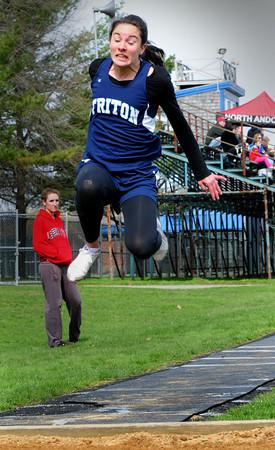 Byfield: Triton's Lauren Robert competes in the triple jump. Bryan Eaton/Staff Photo