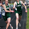 Byfield: Pentucket's Cam Doe, left, takes the baton from Jason Cox in the 4x800 relay at Triton Regional High. Bryan Eaton/Staff Photo
