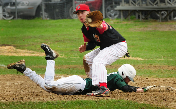 West Newbury: Pentucket's Turner Newton hits first base on a steal attempt as Amesbury's Matt Enaire gets the ball from catcher JC Collette. Bryan Eaton/Staff Photo