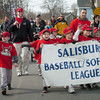 Salisbury: Youngsters march down Maple Street in Salisbury over the weekend on their way to Lion's Park to start the first day of Little League softball and baseball. Bryan Eaton/Staff Photo