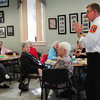 Amesbury: Amesbury Fire Chief Jon Brickett speaks to people at the Amesbury Senior Center on Thursday morning about the importance of carbon monoxide detectors. He and police officer Tom Hanshaw, standing in for police chief Mark Gagnon, were at Coffee With The Chiefs who meet with the senior citizens from time to time. Bryan Eaton/Staff Photo